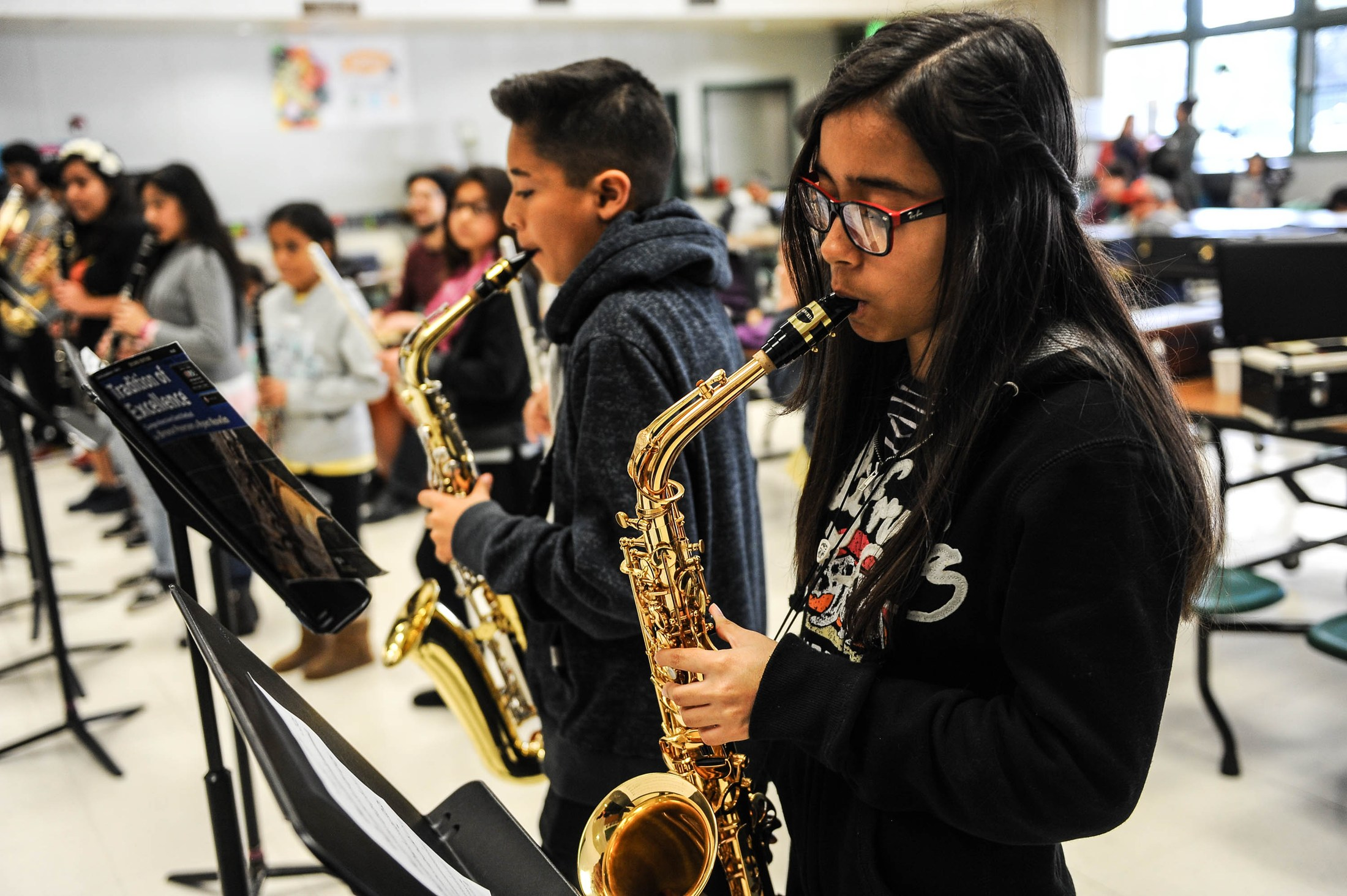 students playing saxophones
