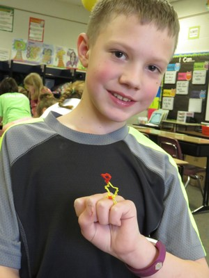 A student shows off the star-shaped ring he made using the 3Doodle pen.