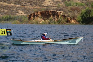 Solar Cup student on the lake with Hemet Unified's boat