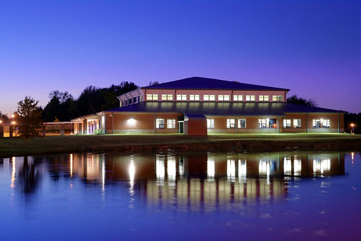 Fine Arts Building with lake in front at night time