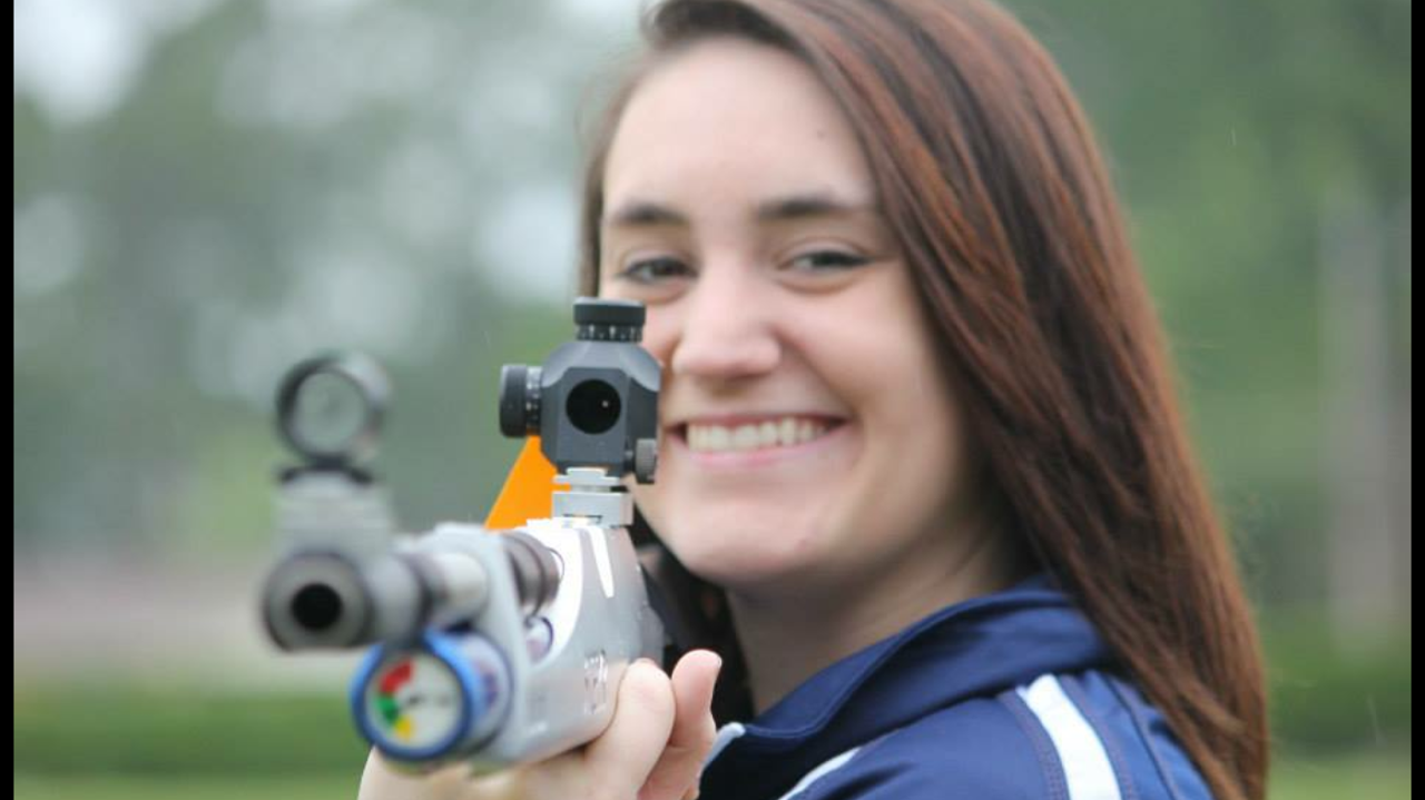 Girl holding air rifle