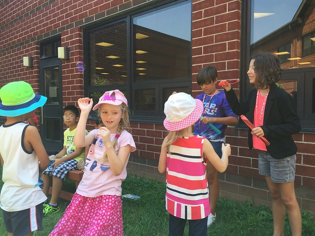 Elementary students practicing their world languages skills