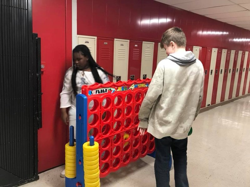 Students playing giant connect four.