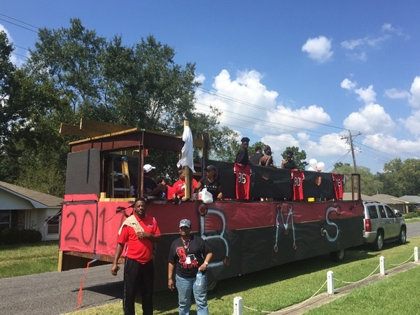 A photo of the Baker School System homecoming float in black and red school colors