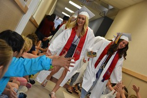 EVHS seniors walking the halls of East Valley Elementary while giving high-fives.