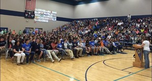 Seniors sitting in rows at college signing day assembly