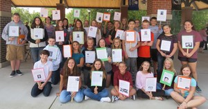 TKMS 8th graders show their work researching victims of the 9-11 attacks.