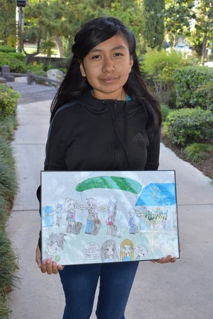 Arlette Florencio Holds her Wining Poster
