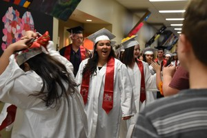 EVHS seniors walking the halls of East Valley Central Middle School.