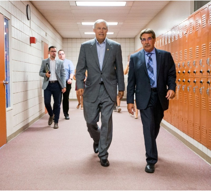 Governor Inslee and Superintendent, John Schieche, walking the halls of EVHS in July 2017.