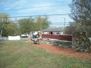 Volunteers work to improve Pilot School grounds.