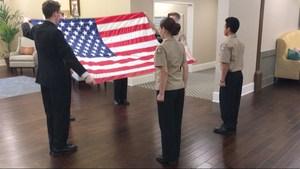 NJROTC members folding the US Flag