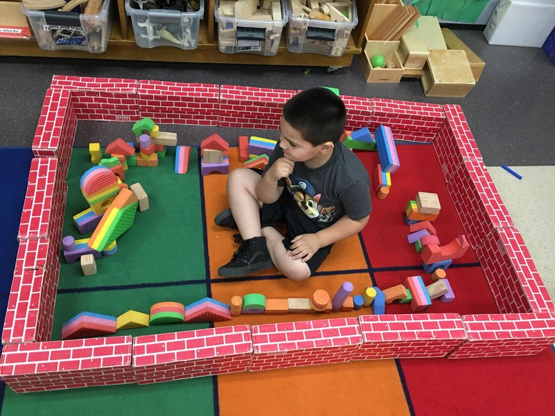 Child putting blocks together