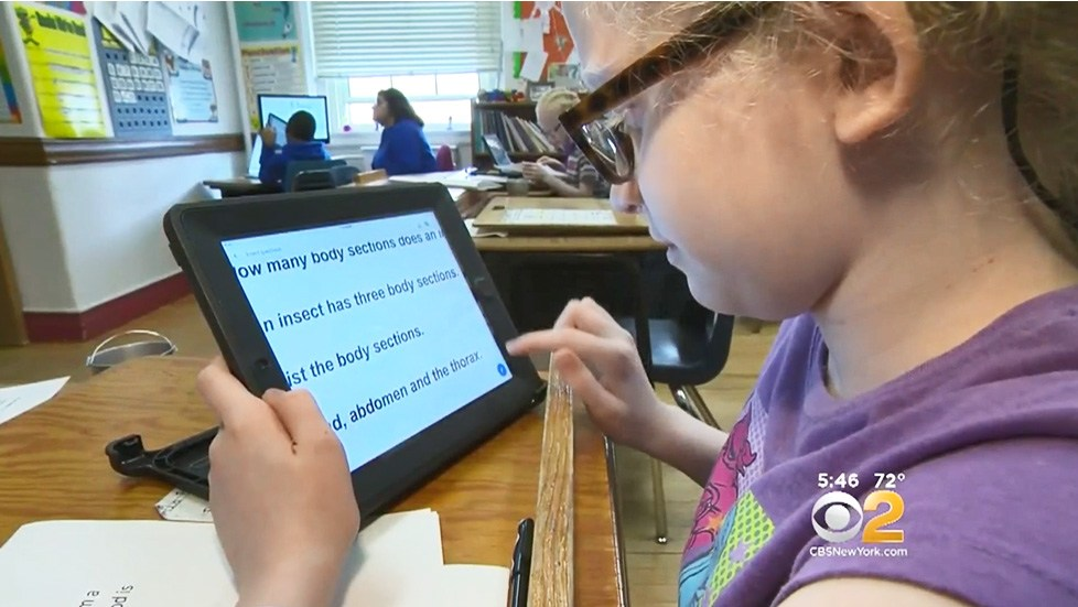 Young student reading on iPad with Voiceover