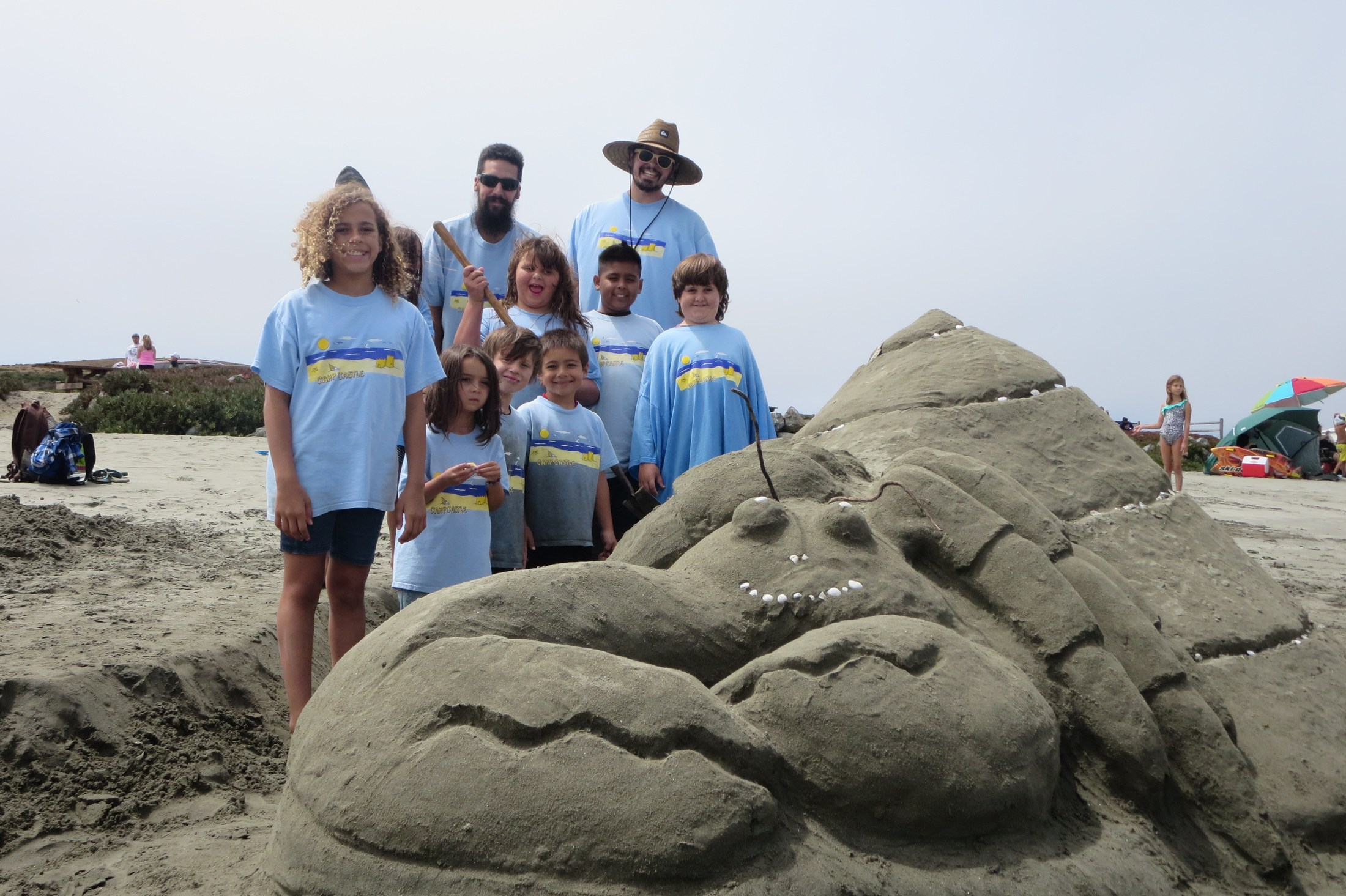 Students with sand castle