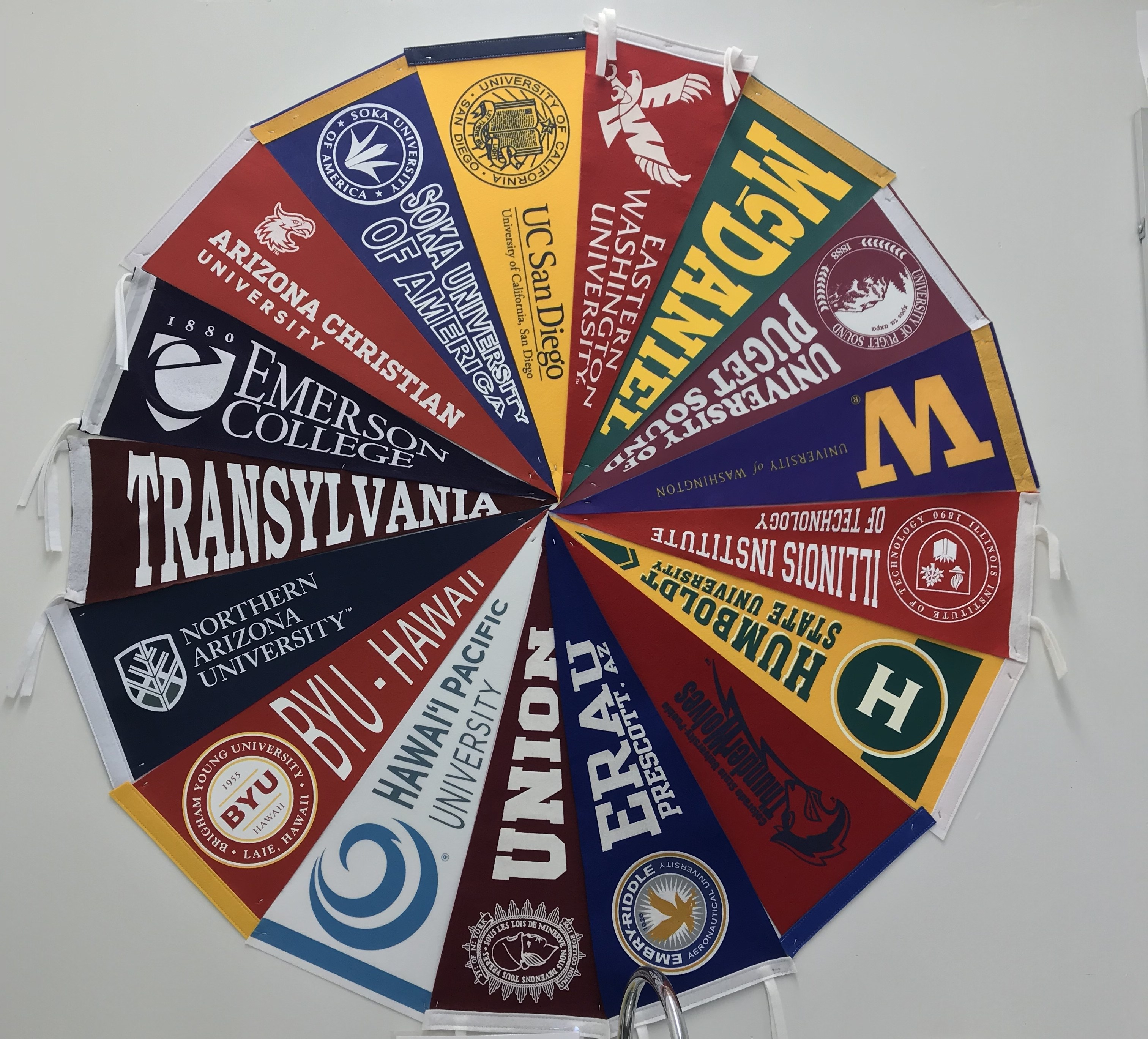A wheel of college flag banners.