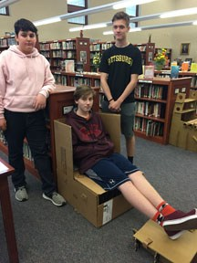 Students in Cardboard Chair