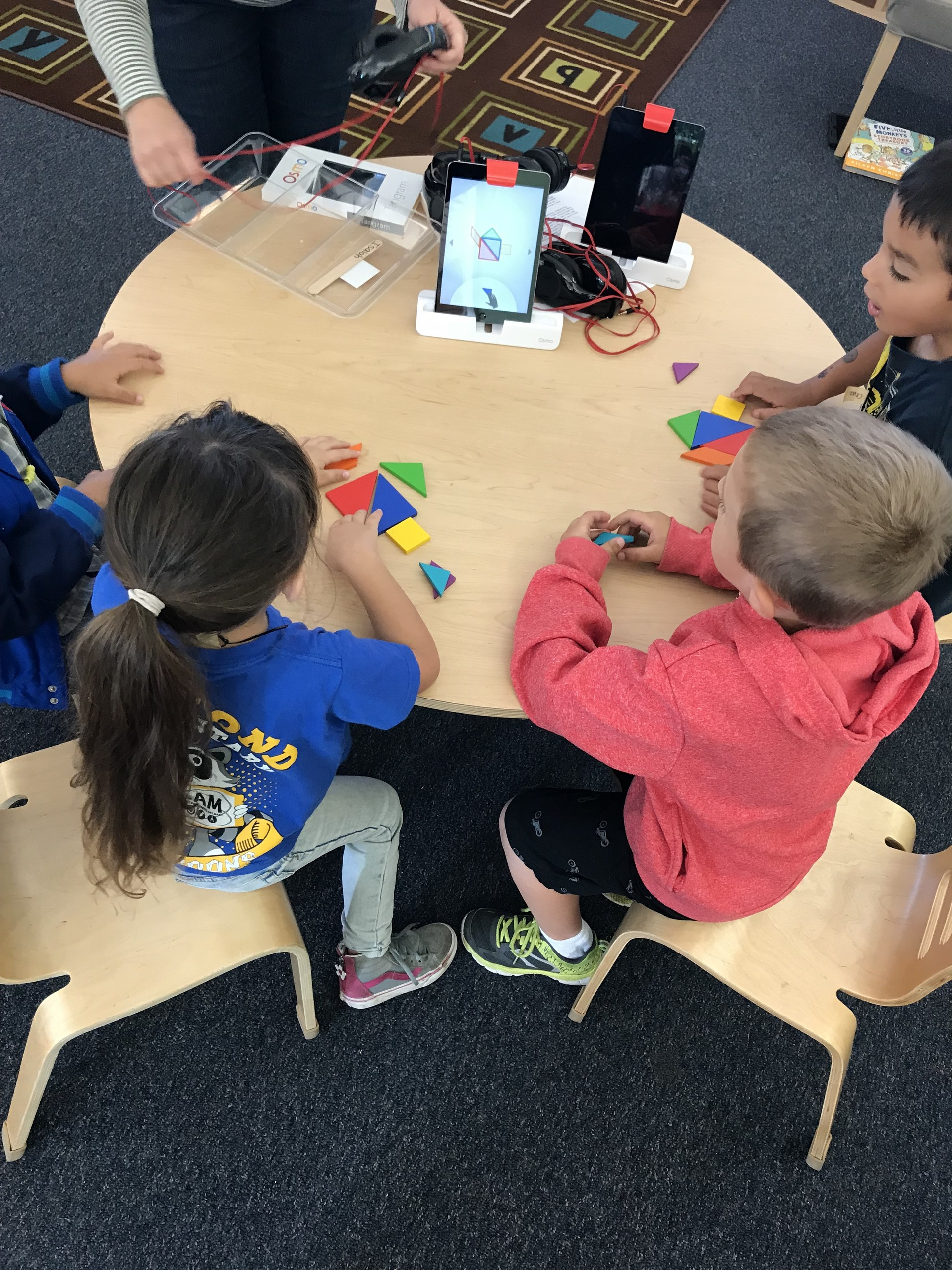 Students using the OSMO as they work with puzzles.