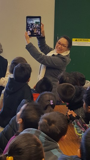 teacher shows off new IPad to students