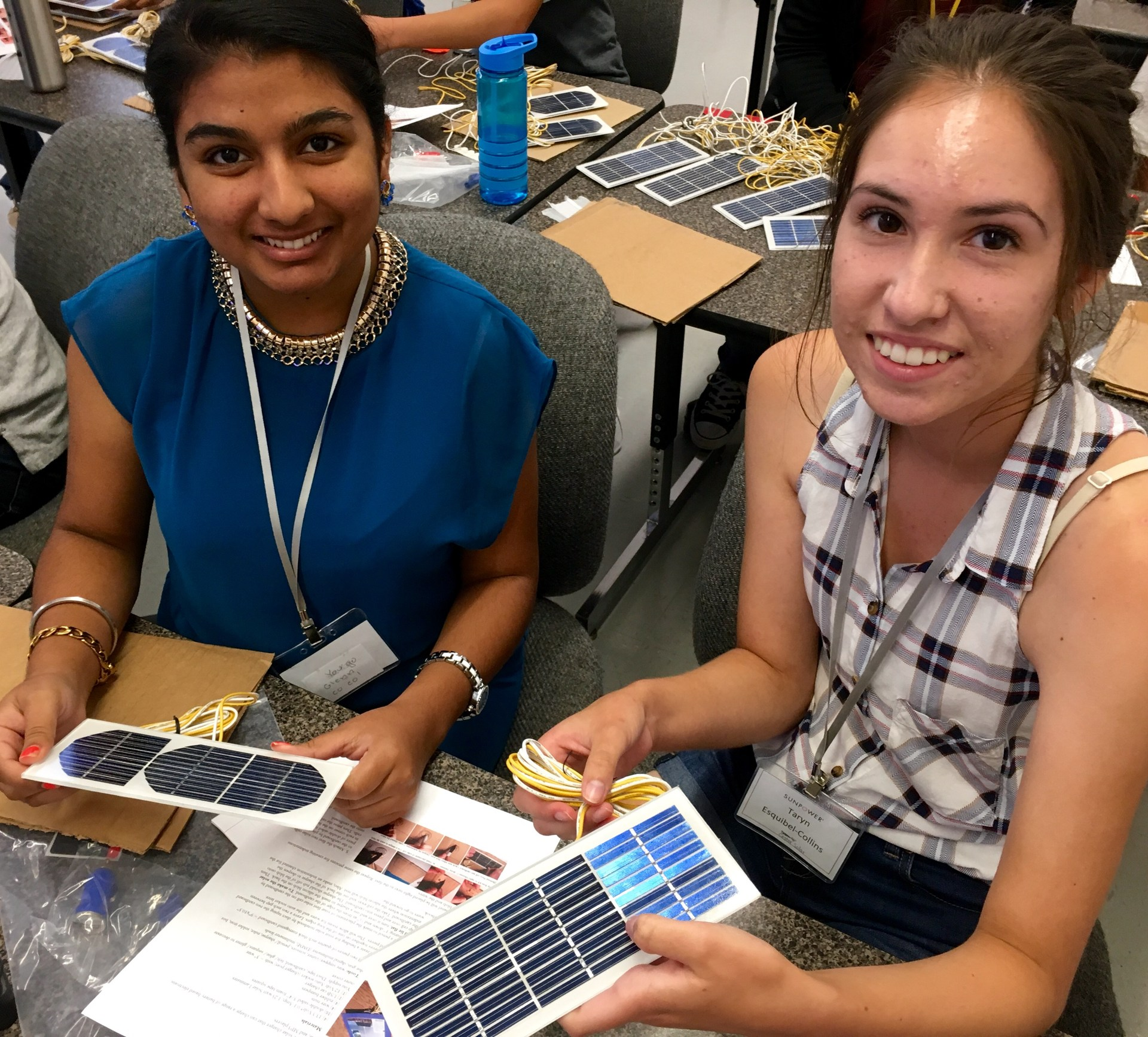 students with solar power devices in Energy class