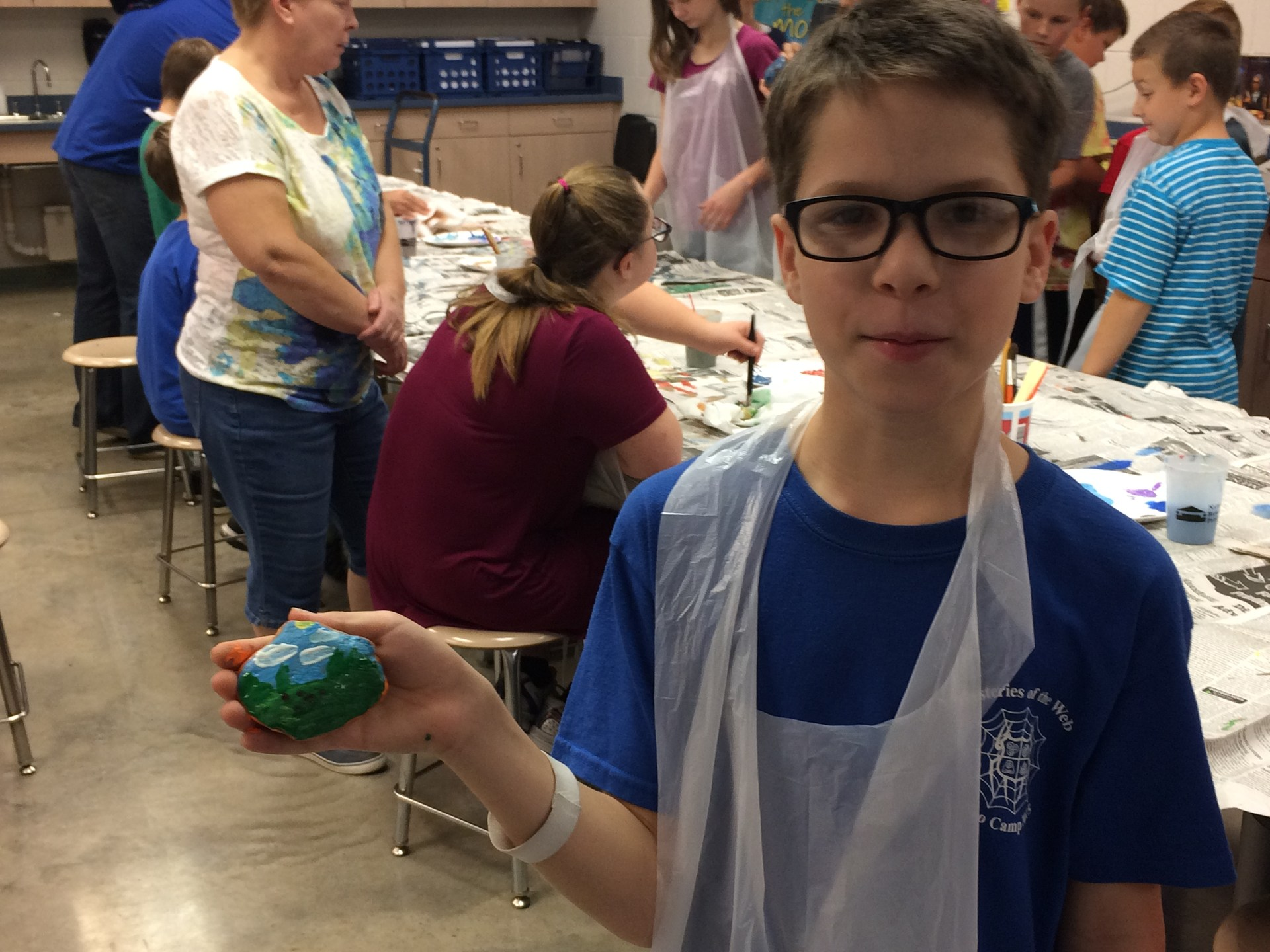 Student Displaying his painted rock
