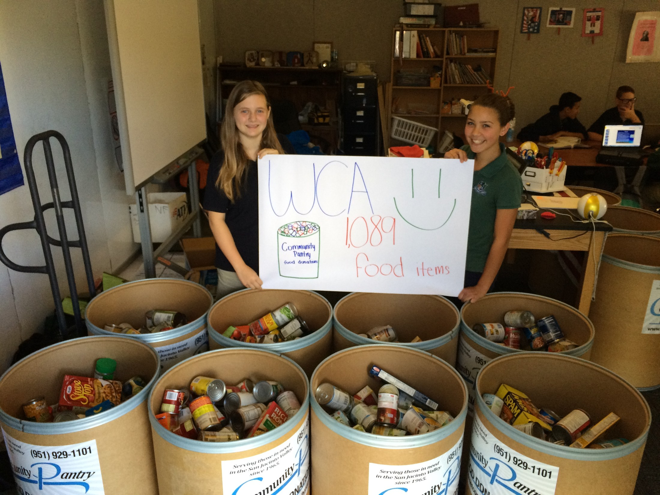 Students collecting food for a food drive