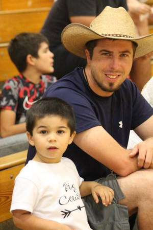 Photo of Kyle Carlson and son.