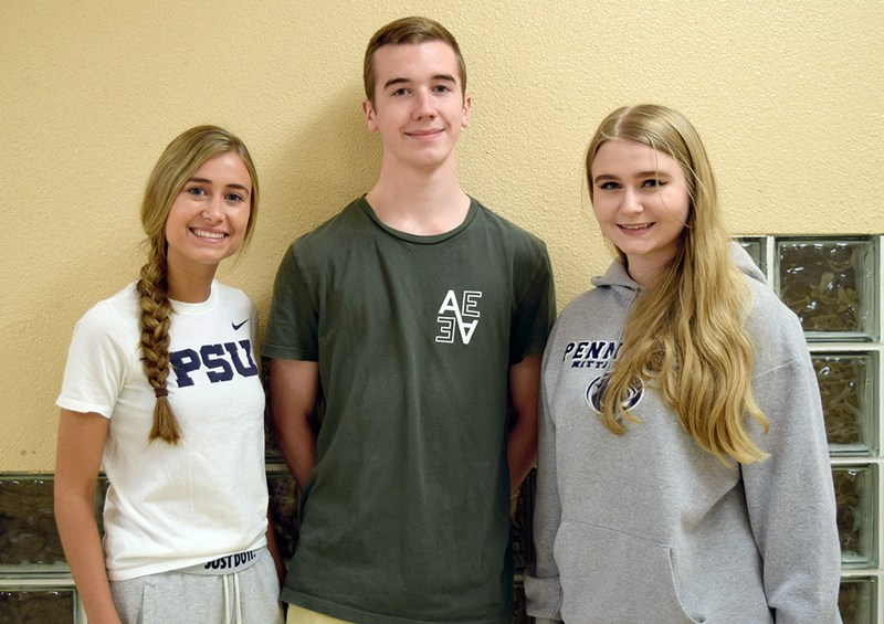 three students posing for a picture