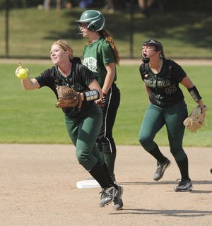 Coloma's Nicolle Larson, left and Mya Potter, right, celebrate an out during a Division 3 quarterfinal against Napoleon on Tuesday.