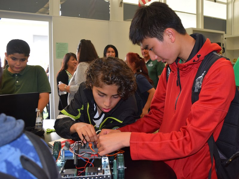 STEM students from Baldwin Park Unified's Holland Middle School adjust wires on their robotic car during a grand-opening celebration of two STEM labs on May 5. Partnered with Project Lead The Way, the District created new labs to accommodate courses in engineering design and modeling, and automation and robotics.