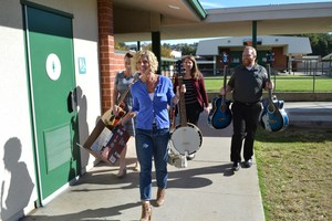 WiSH Education Foundation delivering donated instruments to Sierra Vista Junior High