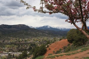 Cloudy Durango with snow on the mountains