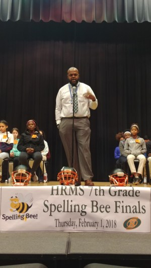 Baines introducing spelling bee competition