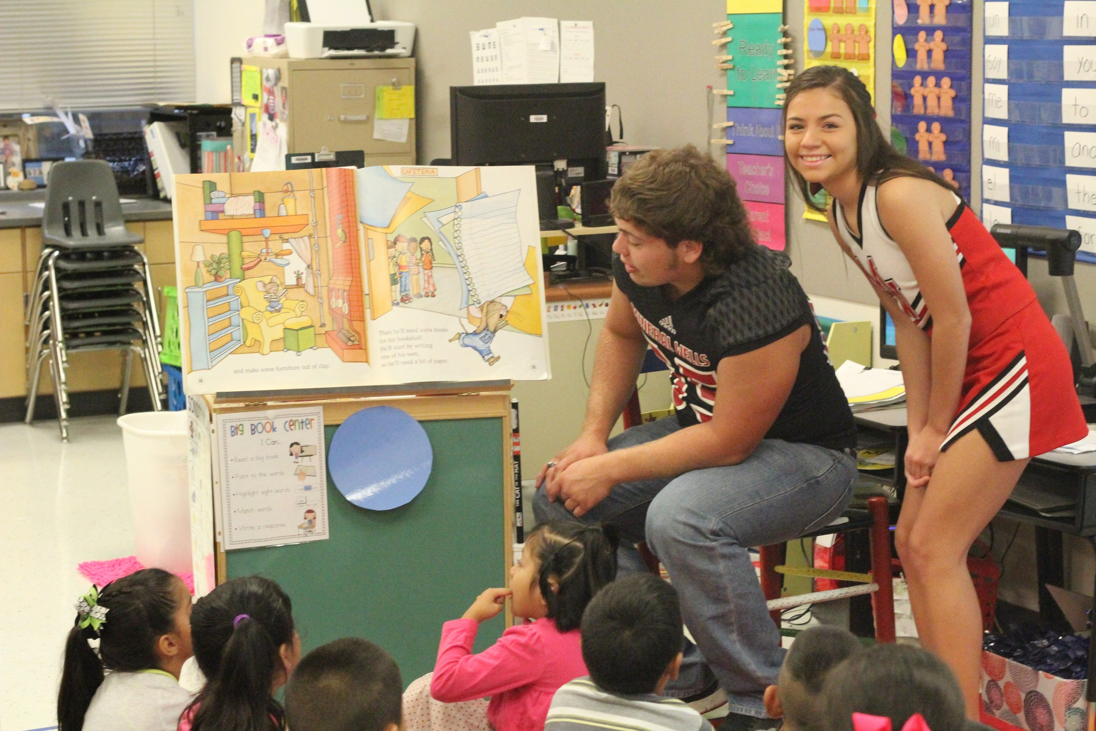 Reading Rams students reading to children