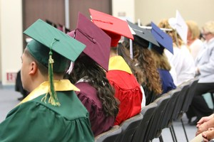 Graduates listening to the Superintendent's speech.