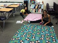 Photo of students creating no-sew blankets