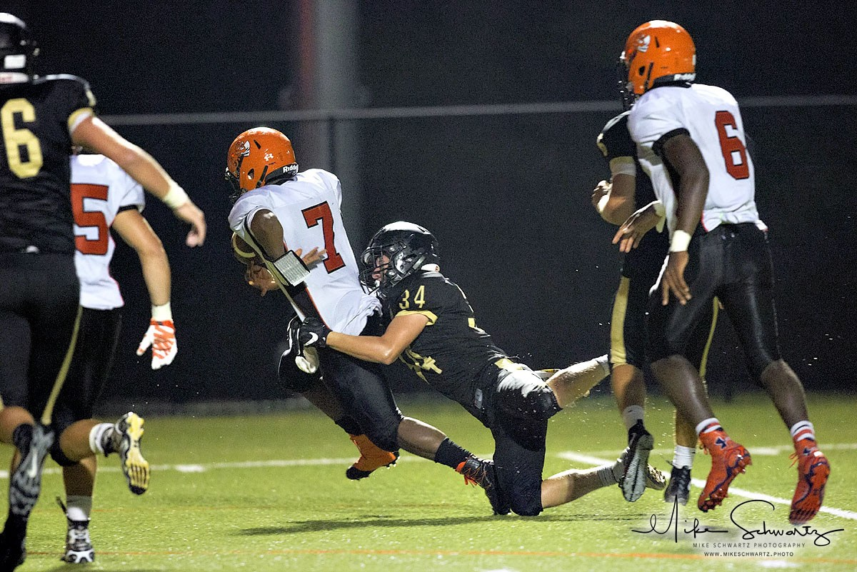 CHS football player makes a tackle