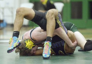 Coloma's Alec DeLaTorre battles South Haven's Hunter Lynch in district action.