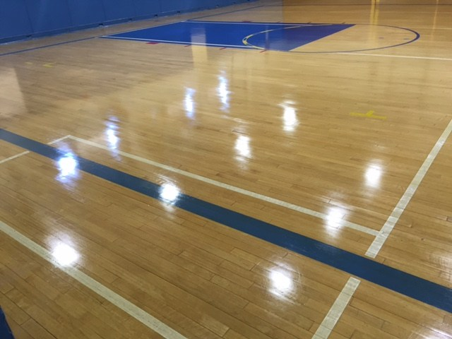 East Whittier Middle School gym floor after waxing.