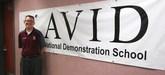 John Bradshaw in front of AVID sign.