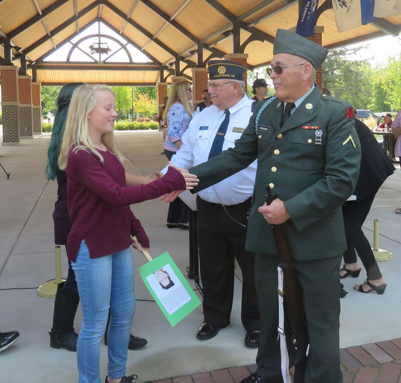 An 8th grader thanks veterans after the Barry County Patriot Day ceremony honoring victims of 9-11-01.