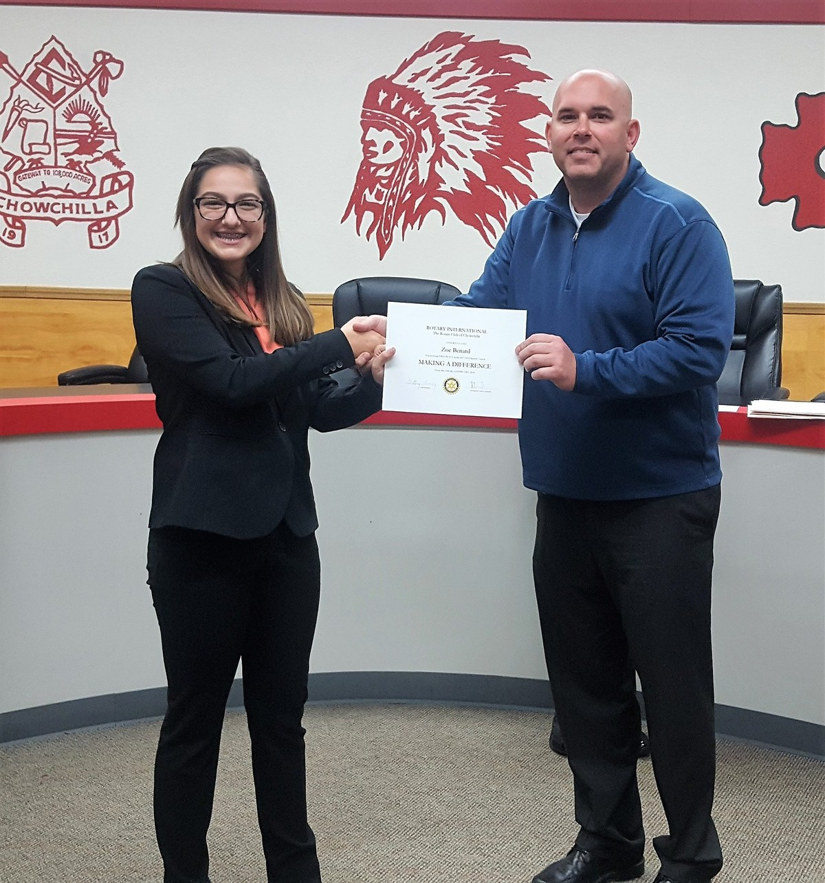 Zoe Benard pictured with Principal Justin Miller receiving award for winning Rotary Speech Contest