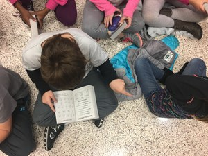 CCI third grade students get new dictionaries and start looking at them immediately