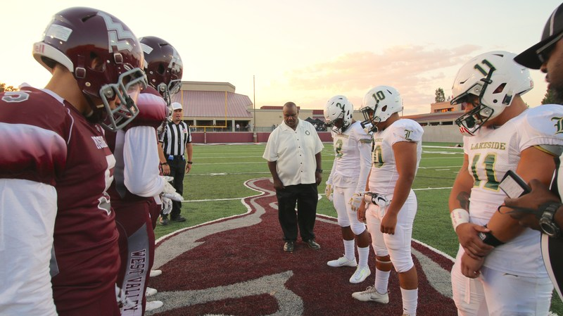 Anthony Pipkins performs coin toss at opening game.