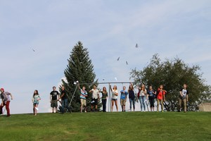 Students throwing paper airplanes near Durango High School.