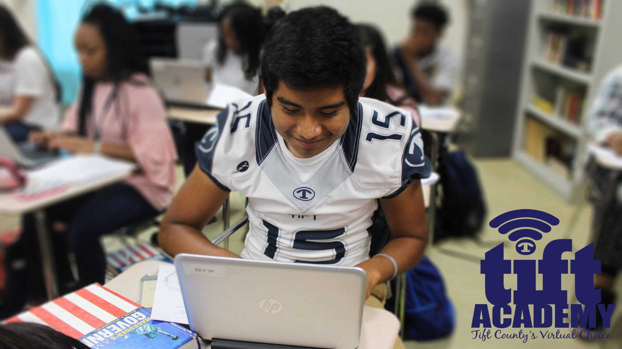 Football Player Working on Computer