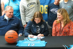 Liz Barwegen signs her letter of intent to play basketball at KVCC