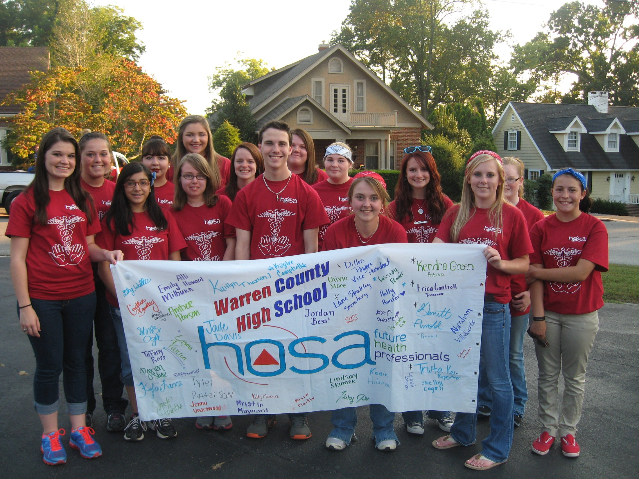 Some of our HOSA members marching in the Home Coming Parade