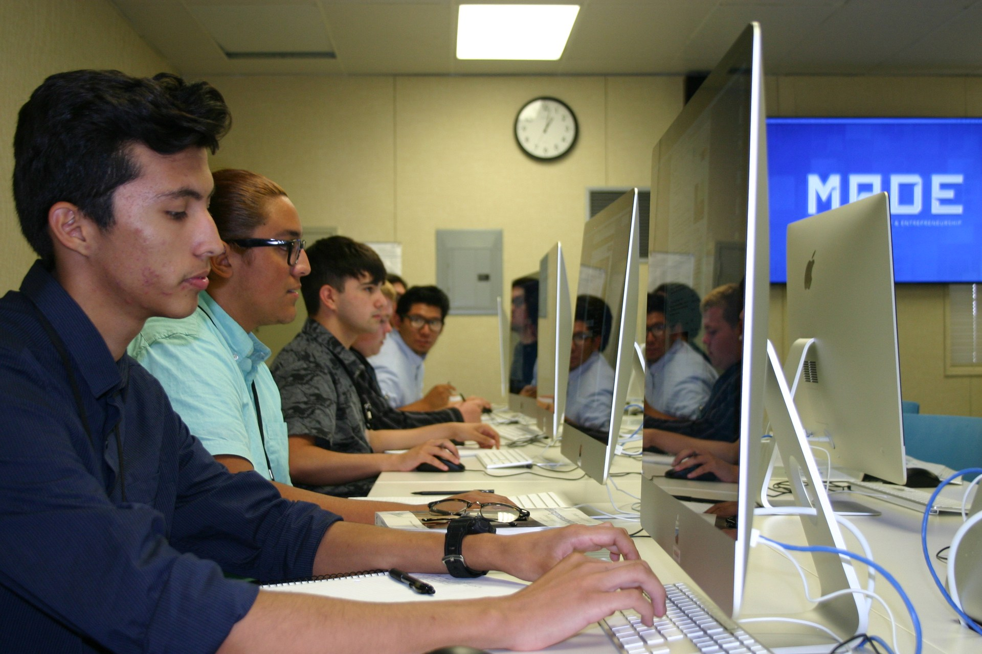 students at computer in mobile app development class