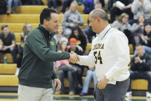 Watervliet Superintendent Kevin Schooley, right, congratulates Coloma Superintendent Pete Bush after the announcement of both schools' United Way of Southwest Michigan campaign totals Tuesday before the start of the boys basketball game at Coloma High School